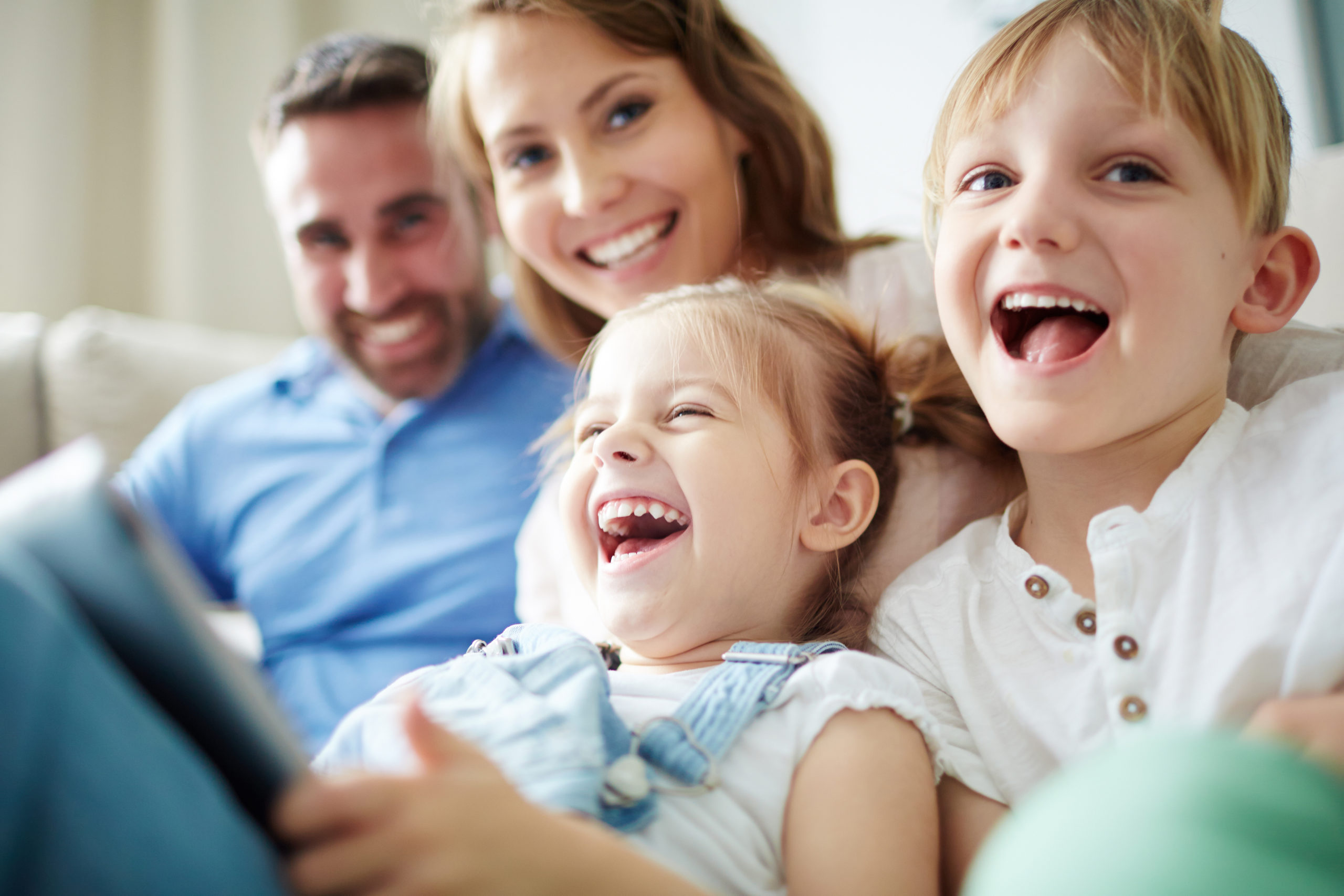 Children sitting together with parents and laughing