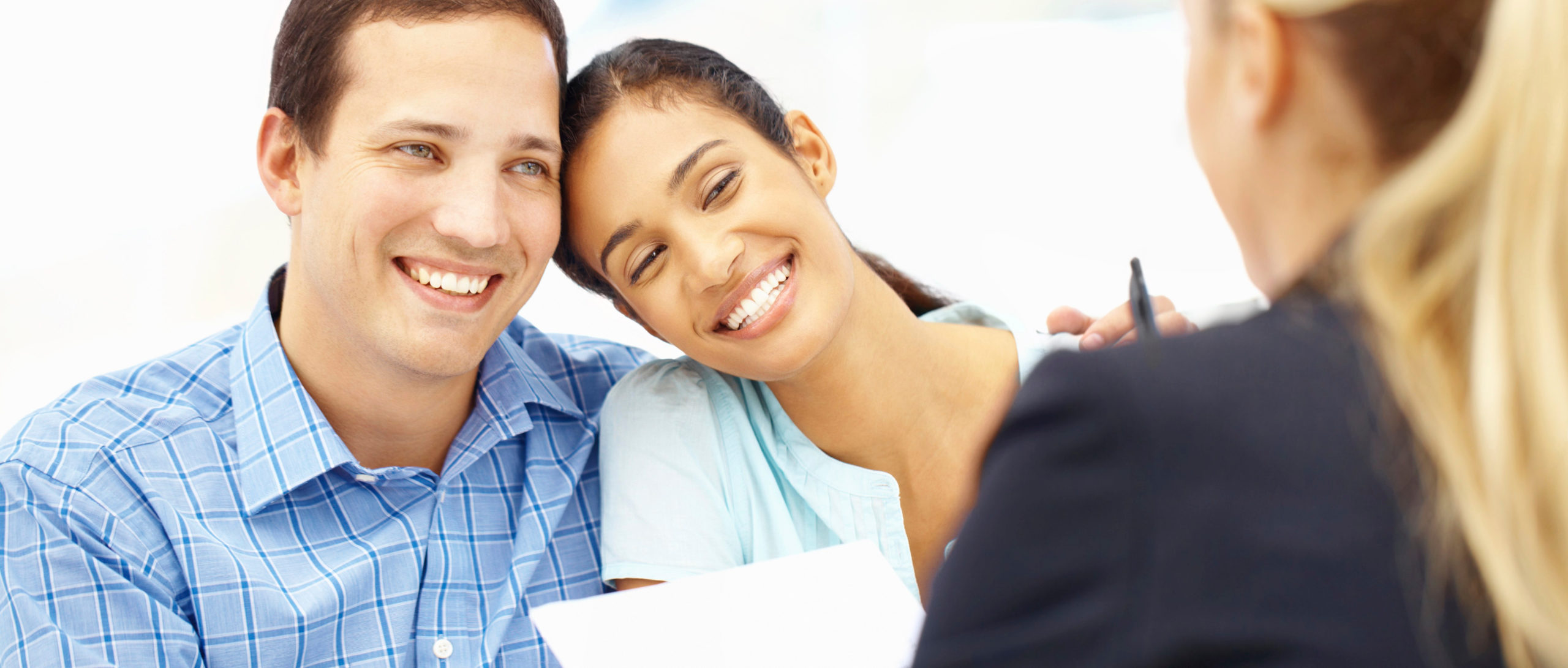 young couple discussing loan with loan officer