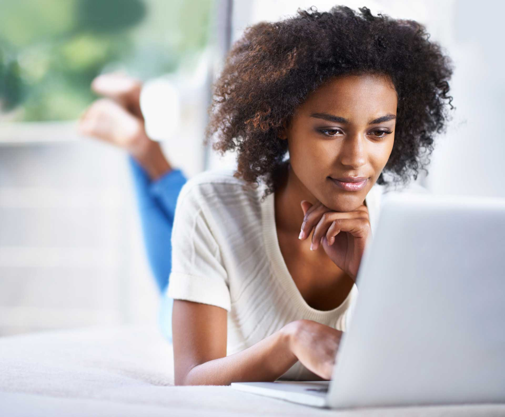 young woman on looking at her laptop